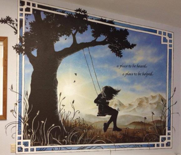 Alaskan artist Jamie Bottoms Held By Hope child advocacy wall mural